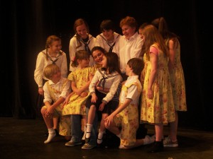 MAC Sound of Music Maria Surrounded by Kids