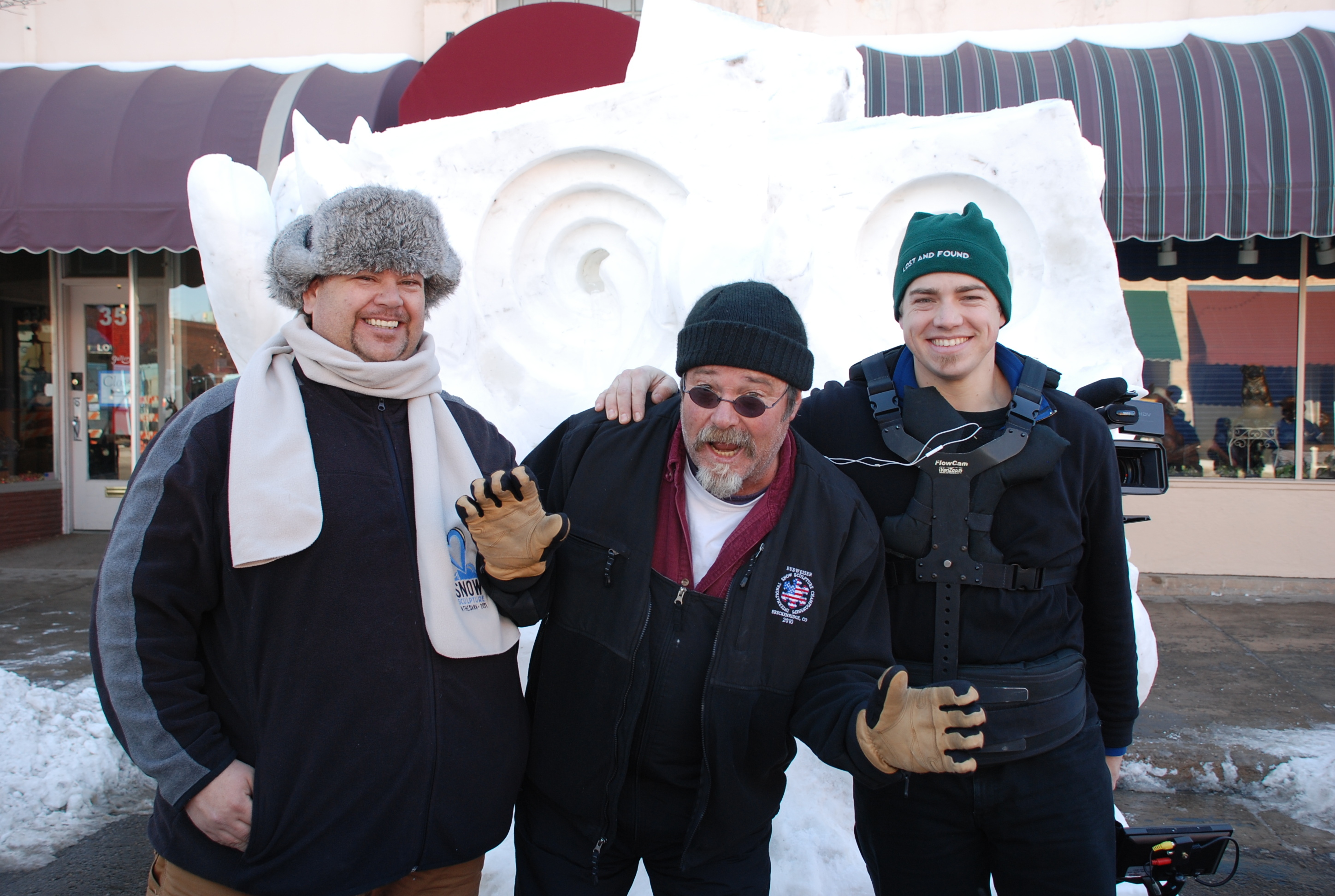 team of snow sculptors at Snow Sculpture after Dark in Loveland Colorado HeidiTown