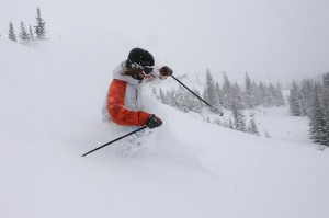 Photo courtesy Breckenridge Resort. Downhill skier in powder.