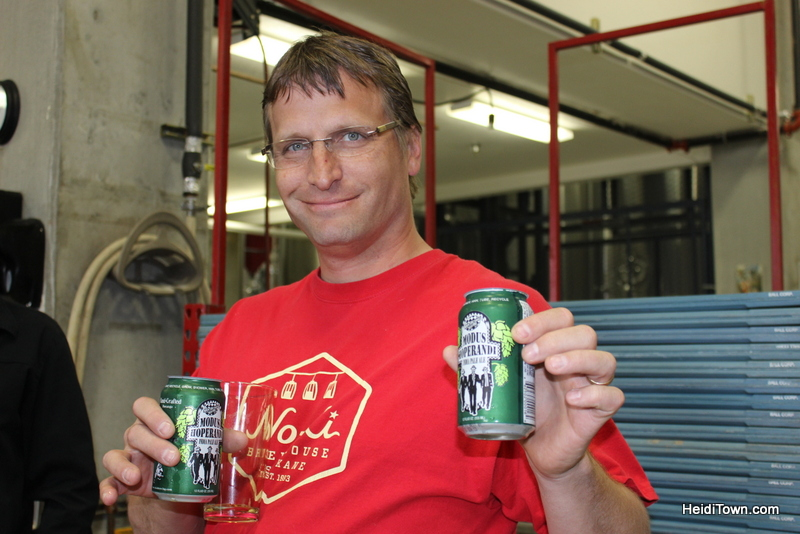 Ryan holding our fresh cans of Modus Hoperandi IPA at Ska Brewing in Durango. HeidiTown.com