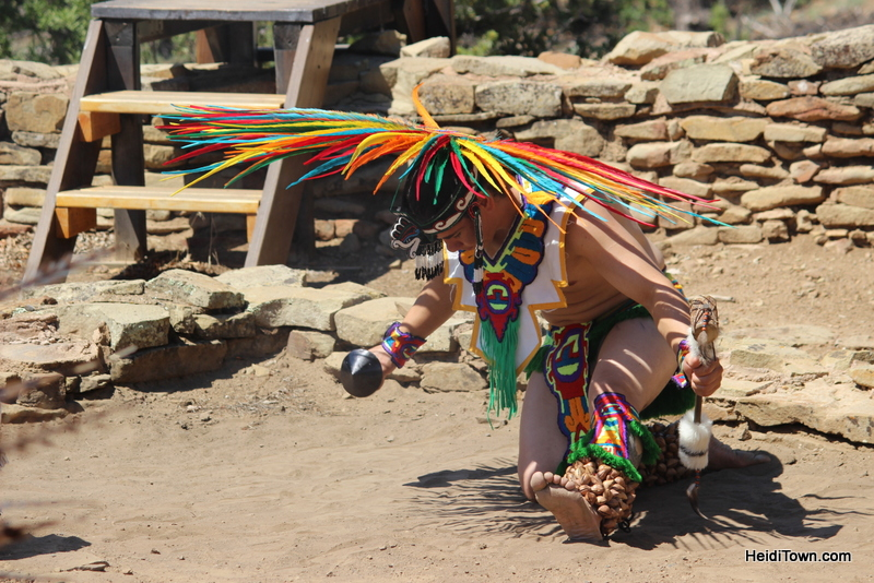 Aztec dancer at Native American Cultural Gathering in Colorado kneels. HeidiTown.com