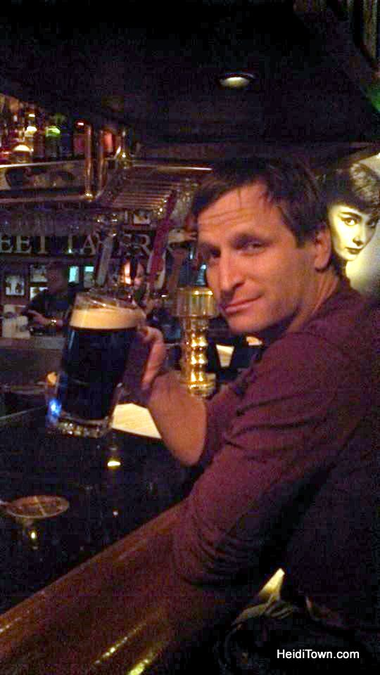 Ryan drinks a huge Guinness at Maloney's on Denver, Colorado. HeidiTown.com