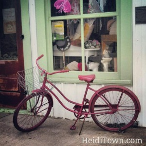 pink bike outside of Simply Shabulous in Berthoud Colorado - HeidiTown