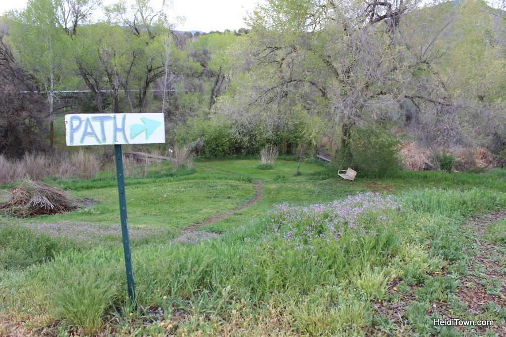 Path sign at Fresh & Wyld Farmhouse Inn & Gardens in Paonia, Colorado. HeidiTown.com