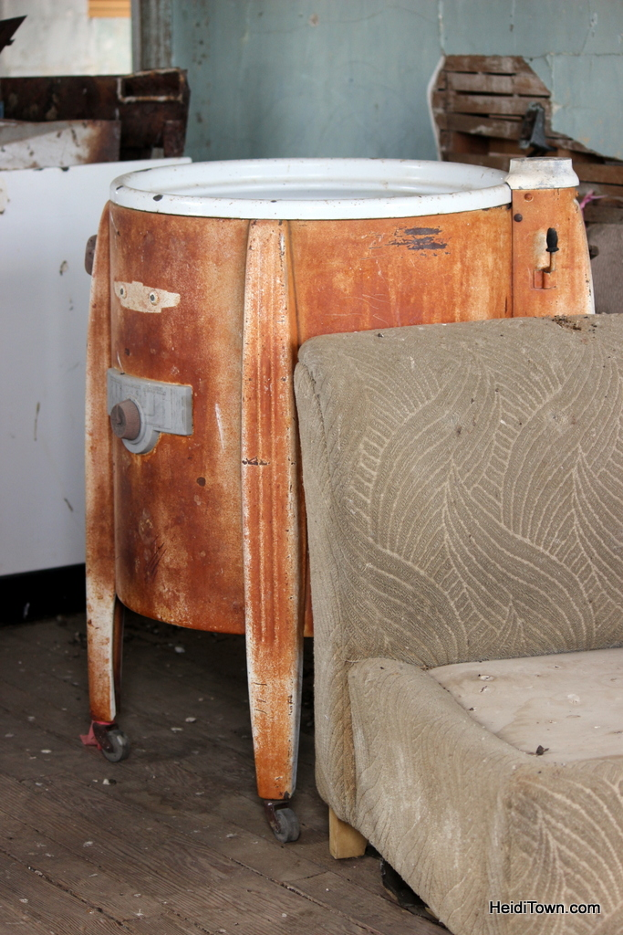 chair and old wash machine in the ghost town of Dearfield, Colorado. HeidiTown.com