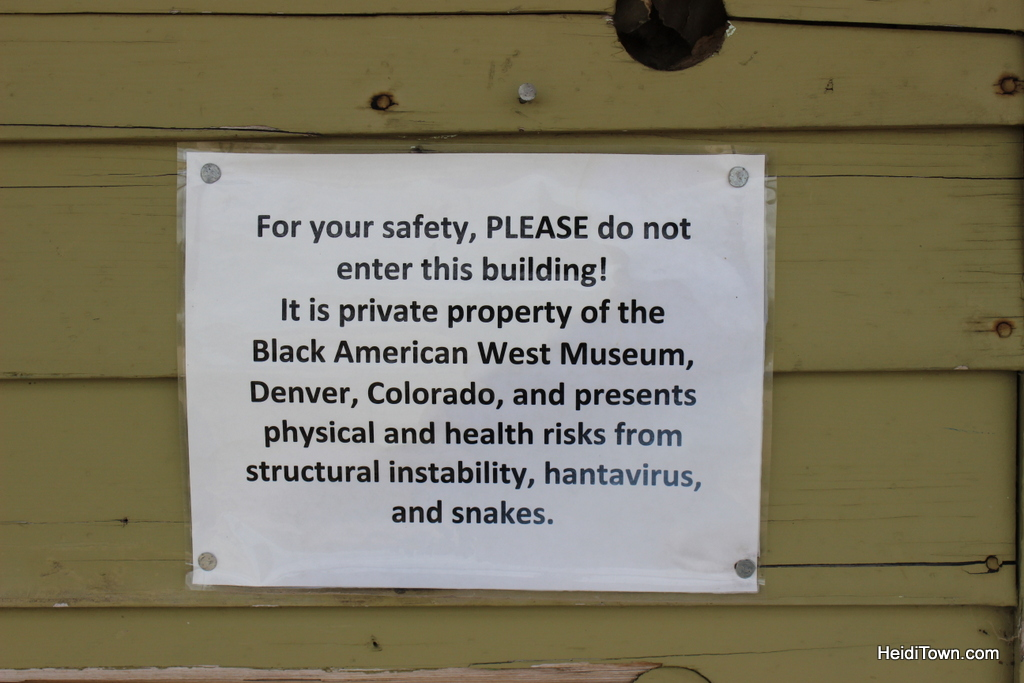 scary sign in the ghost town of Dearfield, Colorado. HeidiTown.com