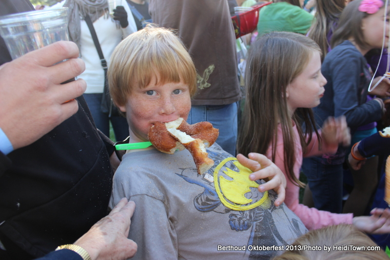 kid with pretzel at Berthoud Oktoberfest. HeidiTown.com