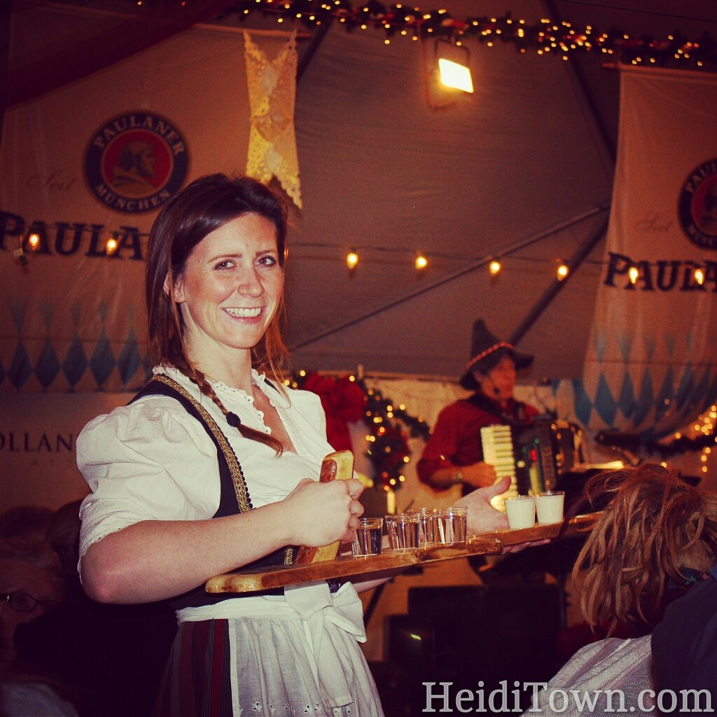 Denver Christkindl Market Heidi selling schnapps under the holiday tent.