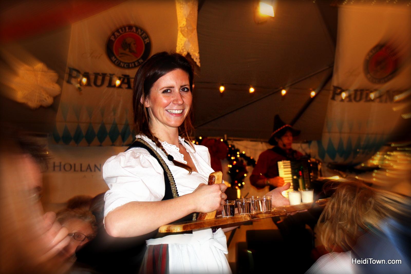 Heidi serving up schnapps at Denver Christkindl Market. HeidiTown.com