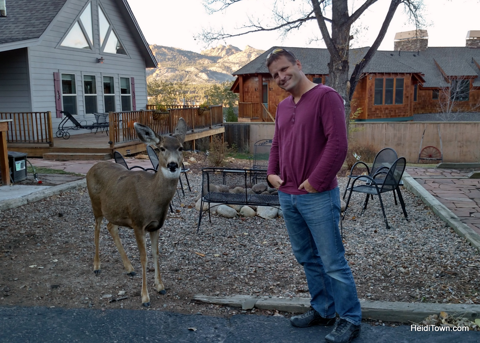 Ryan and a deer post at The Rustic Acre in Estes Park, Colorado, for adult getaways too. HeidiTown.com