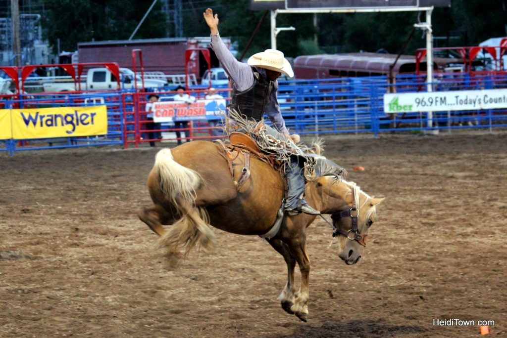 Kickin' it at the Pro Rodeo in Steamboat Springs. Bronco riding. HeidiTown.com