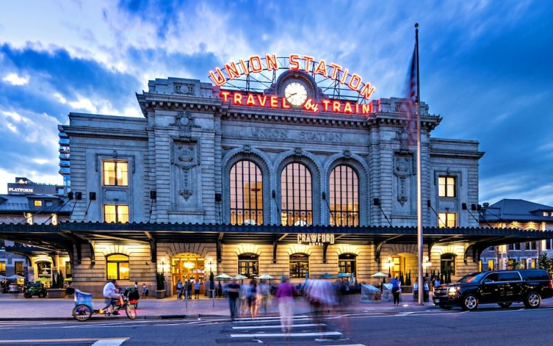 The Best Last Minutes Holiday Gifts in Colorado & Beyond, Denver Union Station Exterior sunset via Julie Dunn