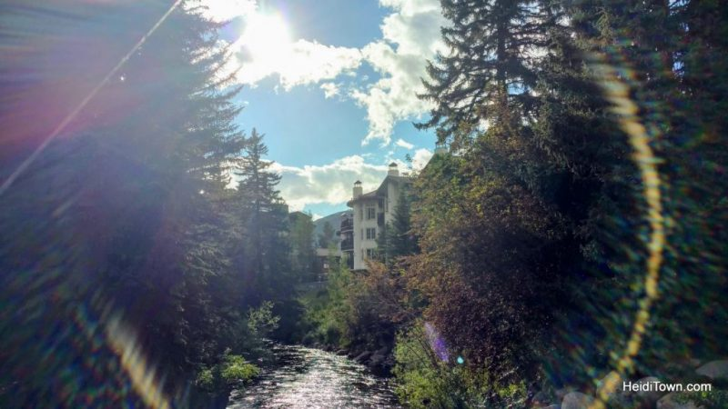 5 Picture Perfect Colorado Summer Towns, a sundog in Vail over Gore Creek. HeidiTown.com